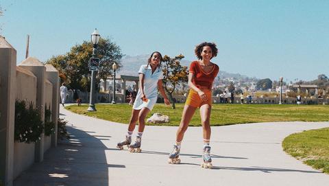2 kids skating in the park